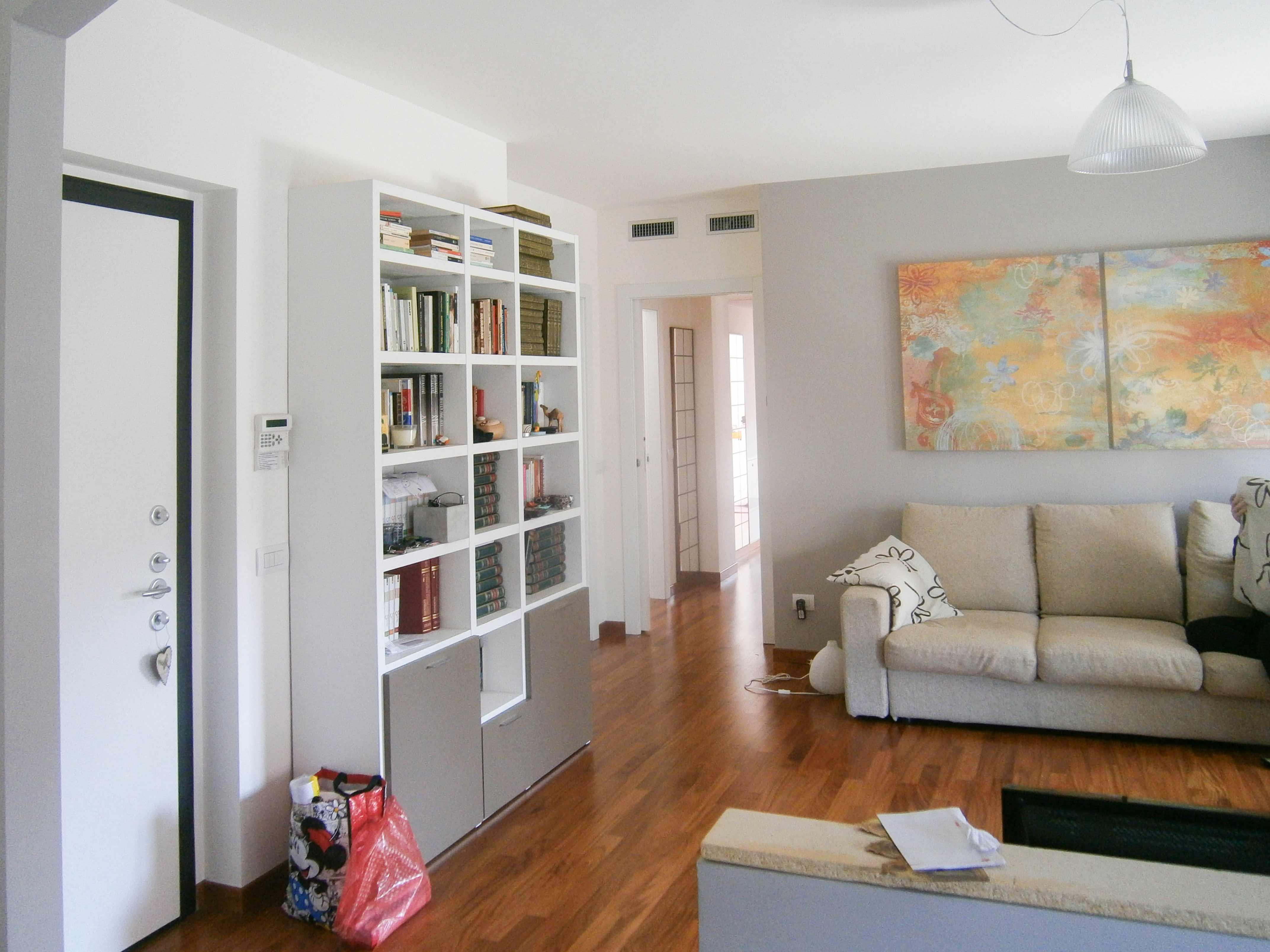 Cucina e soggiorno ad arco con muretto divisorio for Parete divisoria cucina soggiorno